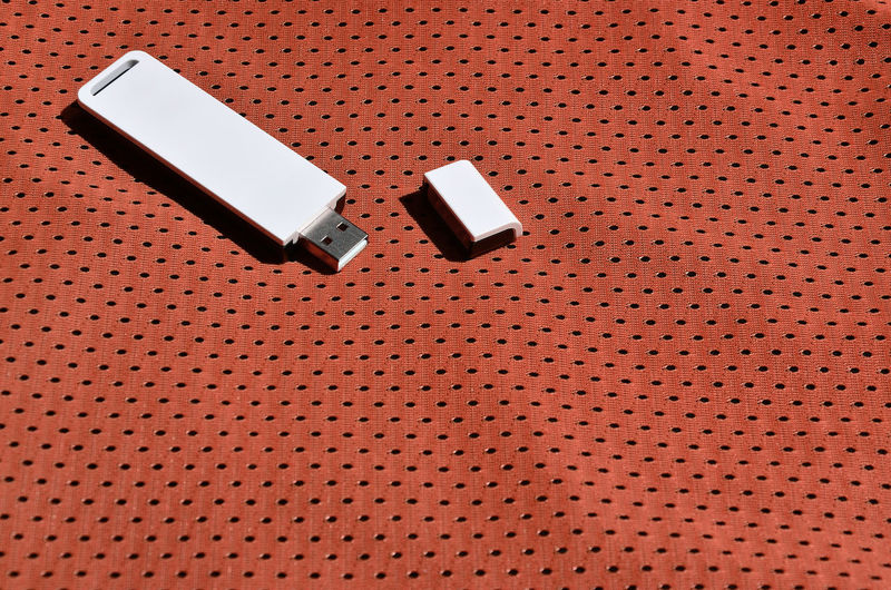 Close-up of usb stick on textile