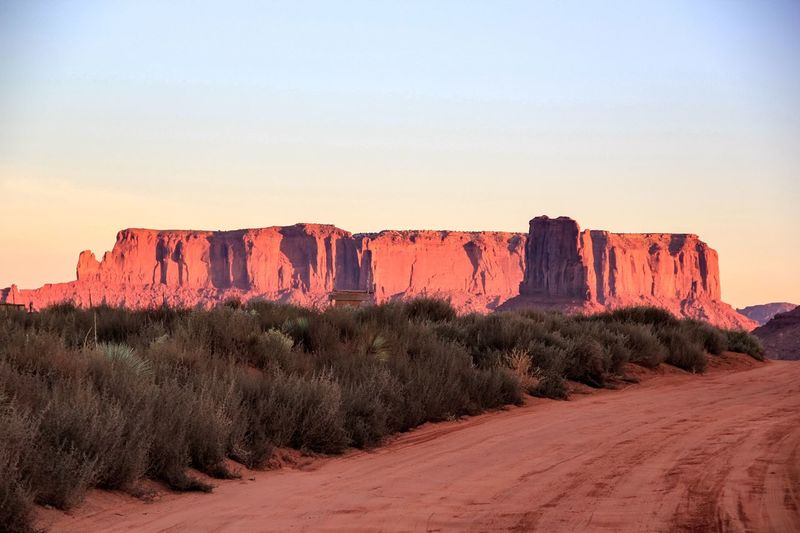 Rock Formation Nature Geology Beauty In Nature Rock - Object Tranquility Physical Geography Scenics Tranquil Scene Travel Destinations Idyllic Landscape Outdoors Sky Monument Valley Tourist Attraction  Tourism Dirt Road Red Sand Miles Away