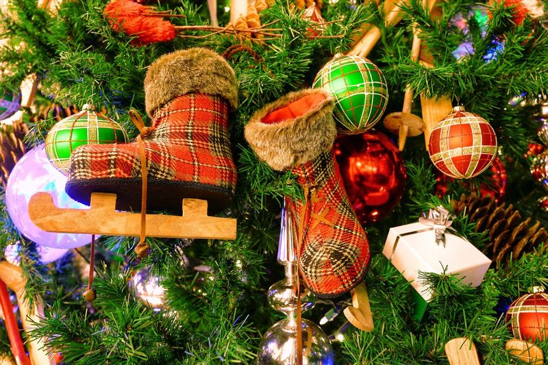 Christmas Trees Christmas Tree Ball Red Green Multi Colored Boots Santa Boot Holiday Decorations Holidays Holiday Christmastime Christmas Decoration Christmas Decoration Celebration Holiday Christmas Ornament Representation Art And Craft Tree Creativity Plant Craft Lighting Equipment