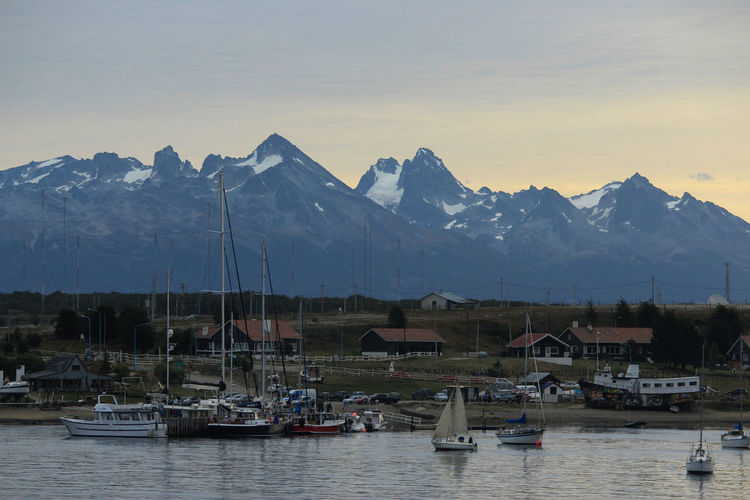 Mountain Sky Water Nautical Vessel Transportation Mountain Range Mode Of Transportation Scenics - Nature Waterfront Nature Beauty In Nature Architecture No People Moored Cold Temperature Sailboat Snow Sunset Outdoors Snowcapped Mountain Mountain Peak Yacht Ushuaia Argentina Travel Destinations