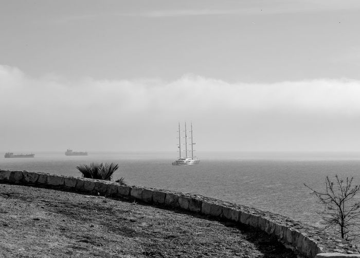 Water Sky Sea Nature Tranquil Scene Scenics - Nature Tranquility Day Architecture Beauty In Nature No People Built Structure Cloud - Sky Land Fog Horizon Tower Beach Non-urban Scene Horizon Over Water Outdoors Lighthouse Blackandwhite Black And White Black & White Yatch Ship Mediterranean