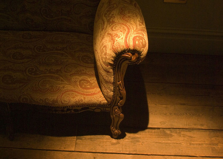 Period style couch. Arm, Sofa, Old Fashioned, Old Style, Shabby Chic, Vintage, Retro, Bare Floor, Floorboards, Close-up Colour Palette, Creativity Dark Electic Light, Indoors  Man Made Object