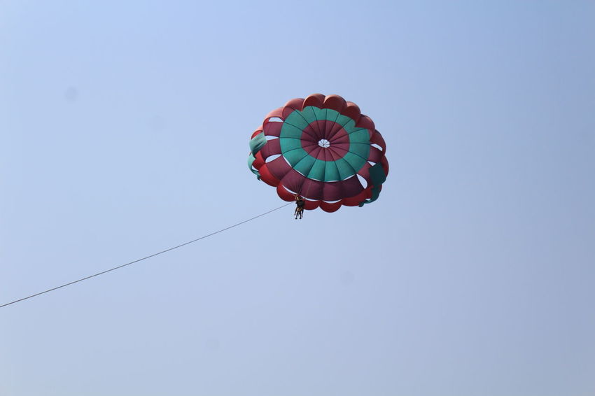 Parachute Low Angle View Red Clear Sky Day Flying Outdoors Parasailing