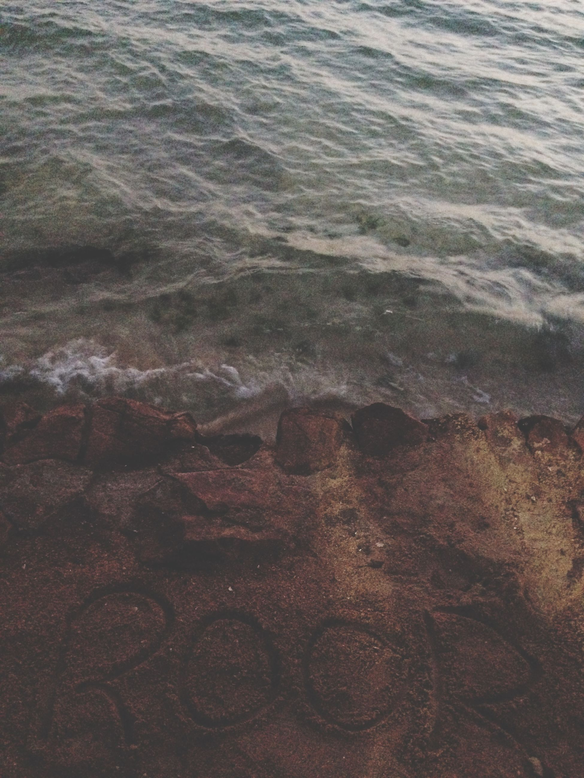 water, high angle view, full frame, backgrounds, sea, nature, beach, rippled, pattern, tranquility, textured, day, outdoors, no people, shore, wave, sunlight, beauty in nature, sand, close-up