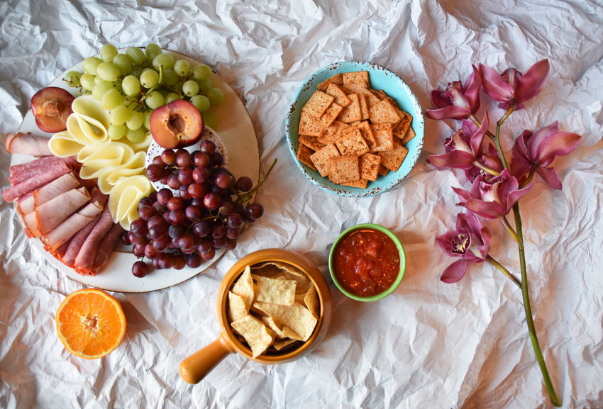 lots of snacks on a crumpled paper, tasty party dish Cuisine Food Styling Ready To Eat Real Food Served Snack Cheese Chips And Dip Crackers Crumpled Paper Deli Delicious Festive Flat Lay Food Food And Drink food stories Freshness Glamour Gourmet Grapes Meat No People Party Tasty