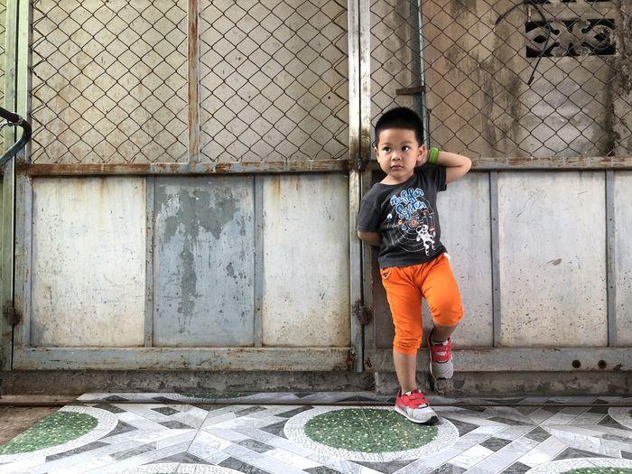 Full length portrait of boy standing outdoors