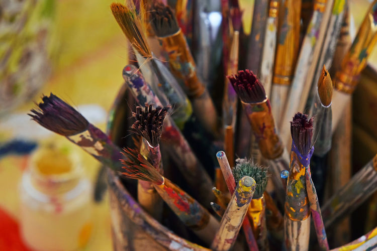 High angle view of paintbrushes in container