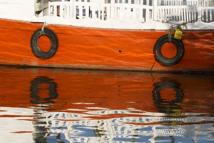 Reflection of moored boat seen in sea