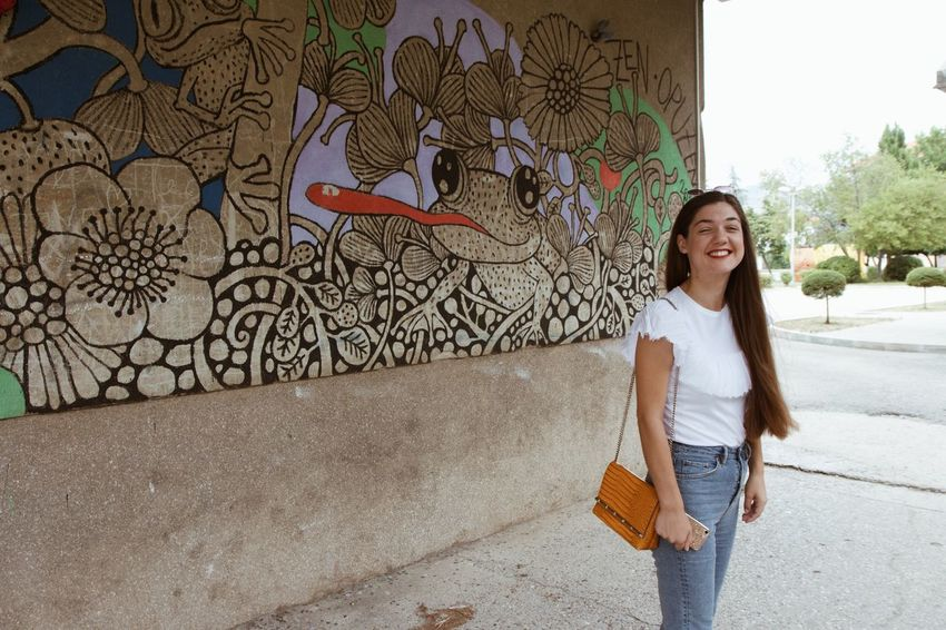 Graffiti Happiness Happy People Model Colorful Retro Styled Travel Destinations Colors Croatia Girl EyeEm Selects One Person Smiling Long Hair Hairstyle Young Adult Architecture Lifestyles Women Looking At Camera Casual Clothing Young Women Portrait Leisure Activity Front View Full Length Adult Real People Outdoors Hair