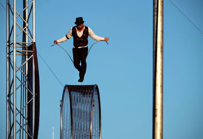 Nebraska State Fair August 2016 Grand Island, Nebraska -- Flippin' - A Steam Punk Theme Aerial & Acrobatic Spectactular Acrobatics  Action Shot  Balancing Act Camera Work Carnival Circus Danger Daredevil Decisive Moment EyeEm Gallery Heights High Above Jumprope Mid-air Nebraska Performance Performing Arts Photography Photojournalism State Fair Steam Punk Stunts Stuntshow Tophat Trapeze Artist