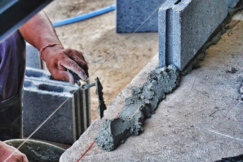 Masonry Cement Concrete Construction Site Work Wall Brick Block One Person Human Hand Real People Hand Human Body Part Day Working Occupation Body Part