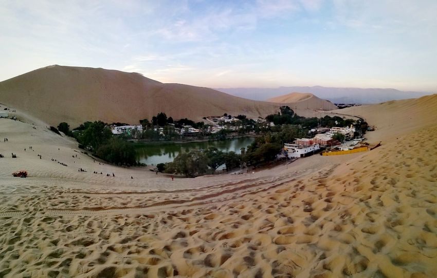 Oasis of Huacachina, Ica, Perù Place Of Heart Sand Sand Dune Water Beach Landscape Desert Mountain Nature No People Outdoors Sky Day Palm Tree Sea Clear Sky Beauty In Nature Fresh 3 Leica Huawei P9 Eye4photography  EyeEm Best Shots Oasis In The Desert Deserts Around The World Desert Desert Landscape Live For The Story