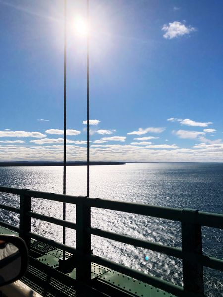 Sunny on Superior Fall Water Love Beauty In Nature Pure Michigan Water Sky Scenics - Nature Beauty In Nature Sea Railing Sunlight Horizon Over Water Tranquility Tranquil Scene Horizon No People Lens Flare Cloud - Sky Day Idyllic Outdoors Sun Nature Transportation