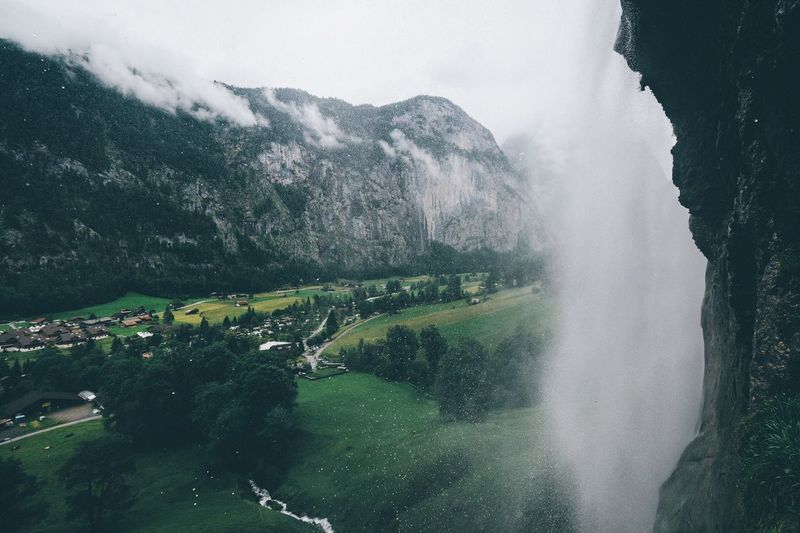 Scenic View Of Landscape And Waterfall