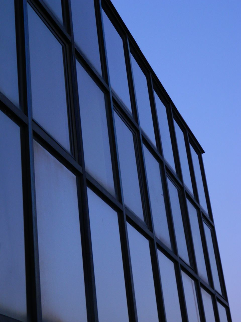 low angle view, window, day, built structure, no people, outdoors, architecture, clear sky, sky, building exterior, close-up