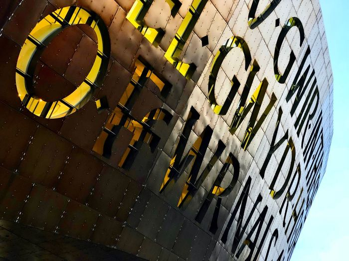 Millennium Centre Low Angle View Communication Text Day Western Script Close-up Outdoors Architecture Pattern Yellow Wall - Building Feature