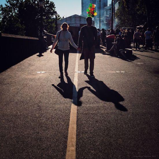 People walking on zebra crossing in city