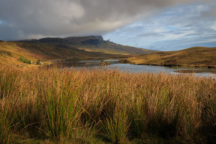 View of Old Man of Storr. - Isle of Skye, 2017 Cloud - Sky Scenics - Nature Tranquil Scene Sky Tranquility Mountain Beauty In Nature Plant Environment Water Grass Landscape No People Lake Nature Non-urban Scene Land Day Outdoors Grassy Old Man Of Storr Isle Of Skye Trotternish Scotland Inner Hebrides Wilderness Escape From The City Remote Travel Destinations Tourist Destination The Great Outdoors - 2019 EyeEm Awards