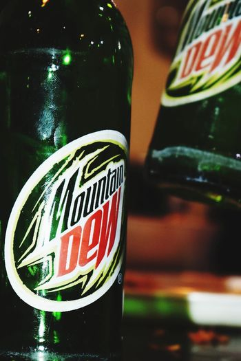 Mountaindew  Mountain Dew Carbonated Cool Drink Logo Text Drink Refreshment Bottle No People Close-up Food And Drink Indoors