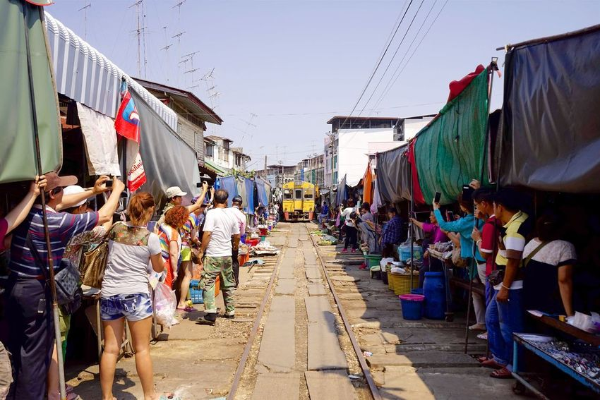Maeklong Railway Market. By SONY A7R Maeklong Railway Market Market Railway Market Thai Architecture Building Exterior Built Structure Casual Clothing City Day Flag Large Group Of People Market Men Outdoors People Railway Real People Sky Train Train Market Train Station Women