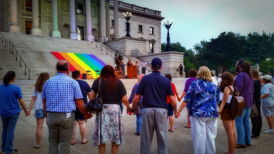 Honor Them With Action, 6/12/17 (4/18 in HDR) -- remembering the massacre at Pulse Orlando on 6/12/16. You can see the non-hdr version on my other account: @simplepoetography. -- The Photojournalist - 2017 EyeEm Awards Hdr_Collection Hdr Edit Photojournalism Rally Memorial Large Group Of People Crowd People Women Men Real People Architecture Built Structure Building Exterior Outdoors Adult Multi Colored Sky Day Group Of People Government Government Building Politics And Government