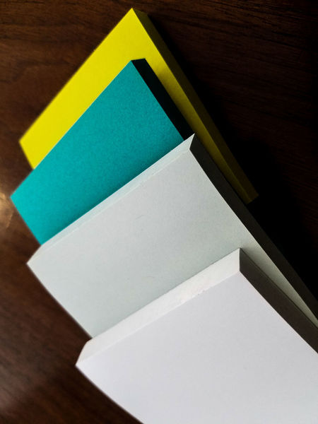 Multi Colored No People Business Finance And Industry Indoors  Close-up Postitnotes Sticky Notes Green Color Green Teal New Wood Table Wood Material Post-It Note Abstract Design Creative Layered Note Papers Paper Assortment Assorted Papers Spring Colors Ideas