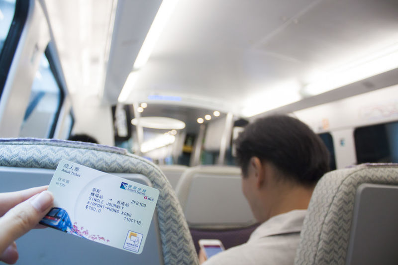 Ticket to HK Mode Of Transportation Real People Transportation Vehicle Interior Travel Sitting Men Journey Lifestyles Vehicle Seat Holding Human Body Part Seat Adult Ticket
