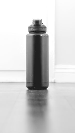 bottle Bottle Bottles Collection Flash Flash Photography Flashlight Minimalism Minimal Minimalist depth of field Blackandwhite Black And White Shadow Shadows & Lights Shadowplay Lighting Equipment Light And Shadow Blackandwhite Photography No Color Black Grey Reflection Aerosol Can White Background Can Aluminum Studio Shot Metal Close-up Focus On Shadow Canister
