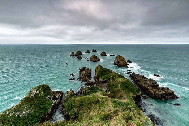 Nugget point is located in south island, new zealand