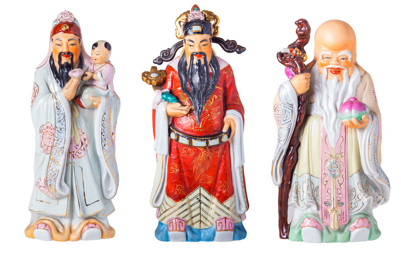 Chinese God of Fortune or Three gods of the Chinese, Fu Lu Shou. (Hock Lok Siew) means Prosperity and Longevity figurine isolated in white , include path Isolated Art And Craft Chinese, Clipping Path Clothing Creativity Doll Female Likeness Fengshui  Figurine  Front View Fu Lu Shou Human Representation Indoors  Male Likeness Multi Colored No People Representation Sculpture Side By Side Statue Still Life Studio Shot Toy White Background