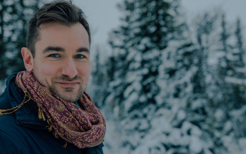 Close-up Cold Temperature Day Focus On Foreground Front View Happiness Headshot Lifestyles Looking At Camera Mid Adult Mid Adult Men Nature One Person Outdoors People Portrait Real People Smiling Snow Tree Warm Clothing Winter Young Adult