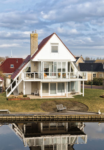 Modern residential buildings in Hindeloopen, Netherlands, Europe Architecture Façade Hindeloopen Home Modern Modern Architecture Netherlands Reflection Balcony Building Exterior Built Structure Canal Contemporary Detached House Friesland Glass - Material High Angle View House No People Residential Building Residential District Residential Structure Town Canal Water Waterfront The Architect - 2018 EyeEm Awards