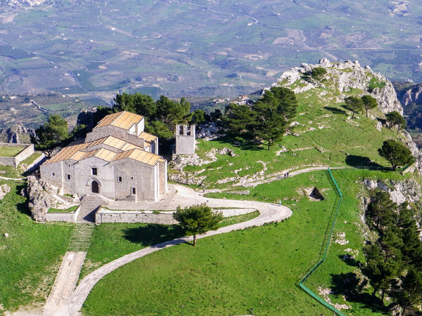 "Aerial view of the church ""Matrice"" of Caltabellotta, a mountain village in south-western Sicily Aerial Aerial View Agrigento Building Caltabellotta Church Grass Hill Italy Landscape Mountain Nature Outdoors Rural Scenic Sicily Sunny Top Town Trees Urban View Village"