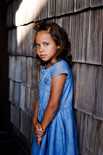 Young Girl Looking At Camera Childhood Child Looking At Camera Portrait One Person Girls Girl Young Girl Check This Out Young Child Summer Summertime Looking At Camera Solemn Serious Face Serious Solemn Moment Beautiful Girl Beautiful Pretty Girl Pretty Dress