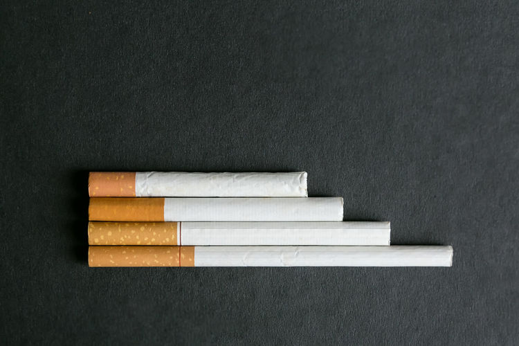 Close-up of cigarettes on table