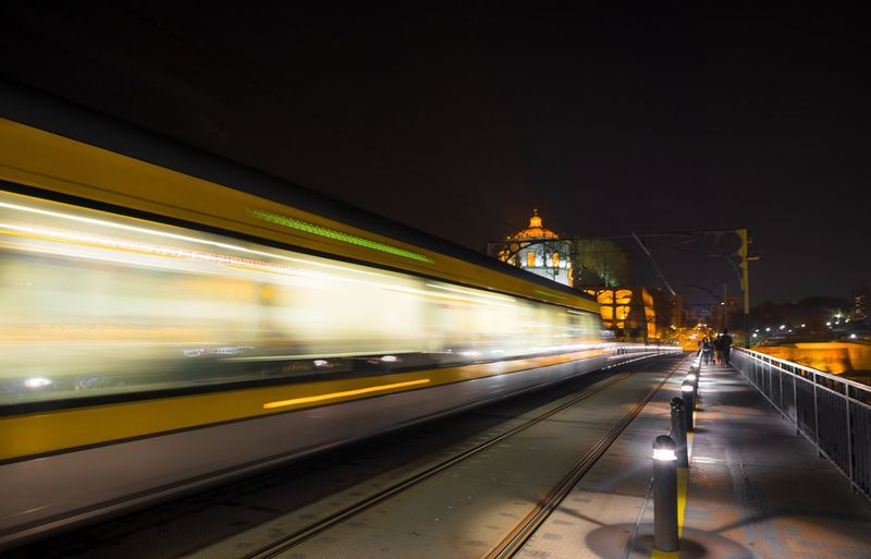 Transportation Illuminated Architecture Night Mode Of Transportation Motion Public Transportation Travel Rail Transportation Built Structure Travel Destinations Blurred Motion Railroad Station City Speed Train Light Trail Train - Vehicle on the move Subway Train