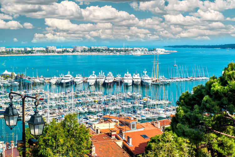 Panoramic view of Le Suquet- the old town and Port Le Vieux of Cannes, France Cannes, France City Cloud - Sky Croisette Europe Famous Place France French Riviera Harbor Landscape Le Suquet Marina Mediterranean Sea Nautical Vessel Outdoors Port Le Vieux Provence Alpes Cote D´Azur Sea Seaside Summer Sunny Day Tourism Travel Destinations Yachting Yachts