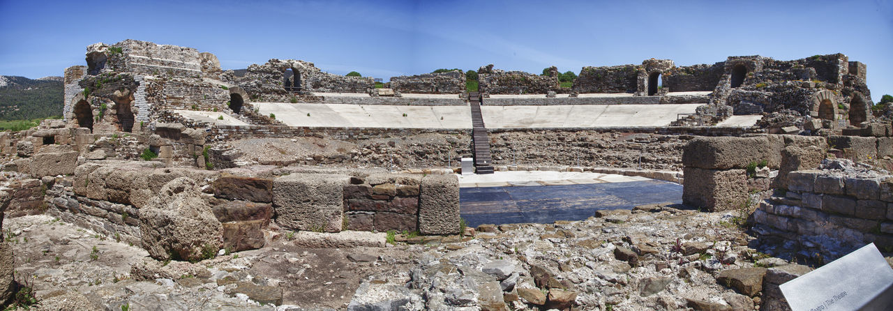 At the Roman Theater of Baelo Claudia Baelo Claudia Ancient Ancient Civilization Archaeology Architecture Building Exterior Built Structure Day Deterioration History Nature No People Old Old Ruin Outdoors Roman Theater Ruined Sky Solid Stone Wall Tourism Travel Travel Destinations Wall