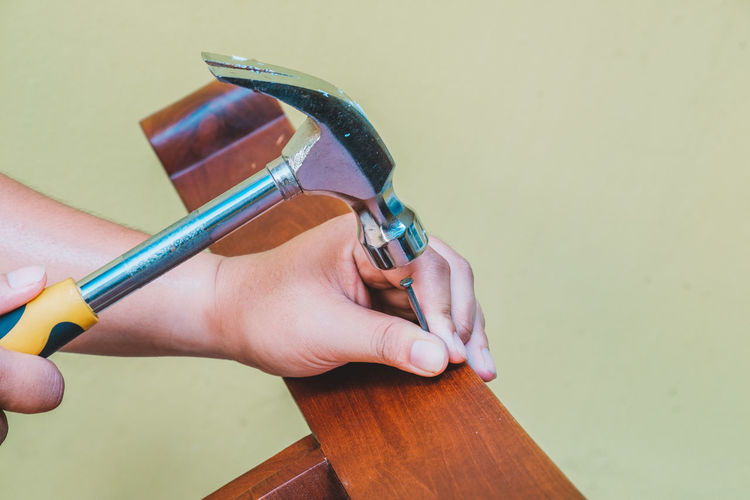 Body Part Close-up Finger Focus On Foreground Hand Hand Tool Holding Human Body Part Human Finger Human Hand Indoors  Metal Nail One Person Real People Studio Shot Tool Unrecognizable Person Wood - Material Work Tool