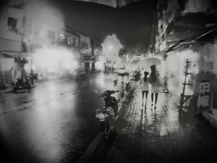 Man on wet street in rainy season