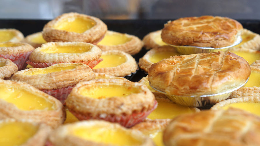 Close-up of hong kong macao iconic egg tarts and pineapple pie pastry sweet dessert