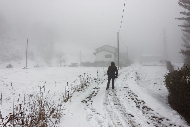 Lonely man walking to home in the winter fog with snowy landscape Adult Alone Art ArtWork Cold Temperature Day Fine Art Fine Art Photography Fog Foggy Morning Life Mistery One Person Outdoors Peace People Silence Snow Snowing Solitude Walking Walking Alone... Winter Winter Wintertime