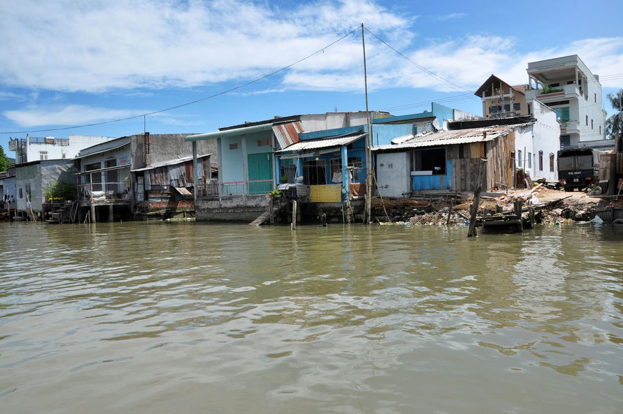 CAN THO, VIETNAM - FEBRUARY 17, 2013: Typical shack homes, riverside houses along the Mekong Delta. People from the suburbs are living in poverty with a low standard of living Home Mekong Mekong Delta Mekong River Poverty Lives. Riverside Viet Nam Vietnam Architecture Boat Building Exterior Built Structure Cai Rang Can Tho Day Delta Lifestyles Mekongriverside Outdoors Poverty River River House Riverbank Shack Water