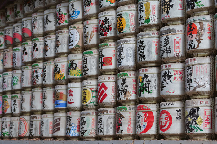 Painted sake barrels at Meiji Shrine in Tokyo, Japan. EyEmNewHere Meiji Shrine Sake Barrels Abundance Alcohol Arrangement Backgrounds Barrel Close-up Drink Full Frame In A Row Large Group Of Objects Meiji Multi Colored No People Stack Wine Cask The Traveler - 2018 EyeEm Awards