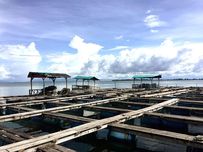 Fish farm Sun Sunlight Fish Fishfarm Blue Cloud - Sky Sea No People Day Water Sky Beauty In Nature Outdoors Landscape Tranquility Ocean View Rustic Miles Away