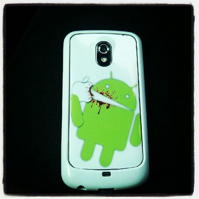 My new Case and skin for my Galaxynexus  Android eating Apple