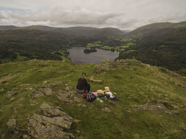 Trekking Woman Adult Beautiful View Beauty In Nature Cloud - Sky Dog Environment Lake Leisure Activity Mountain Mountain Range Nature Outdoors Pet Pet Owner Positive Emotion Rear View Scenics - Nature Sitting Togetherness Walker Evans Water