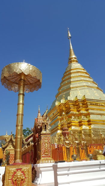 Doi Suthep,Chiangmai Architecture Buddhism Clear Sky Cultures Day EyeEm Best Shots Gold Gold Colored Intricacy Moon No People Outdoors Peace Place Of Worship Religion Sky Spirituality Statue Travel