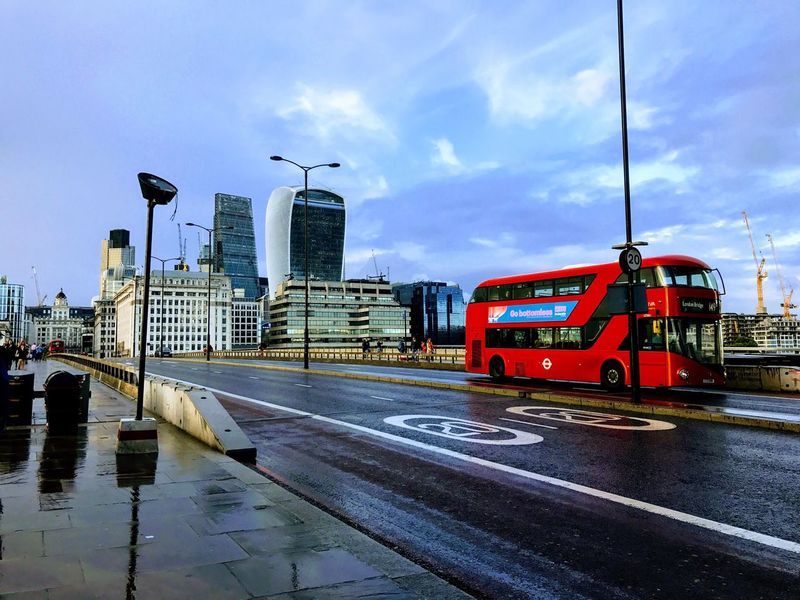 EyeEm LOST IN London Sky Transportation Architecture Cloud - Sky Wet Built Structure Mode Of Transport Building Exterior No People Outdoors Day City Water London Bus Iconic London Red Bus