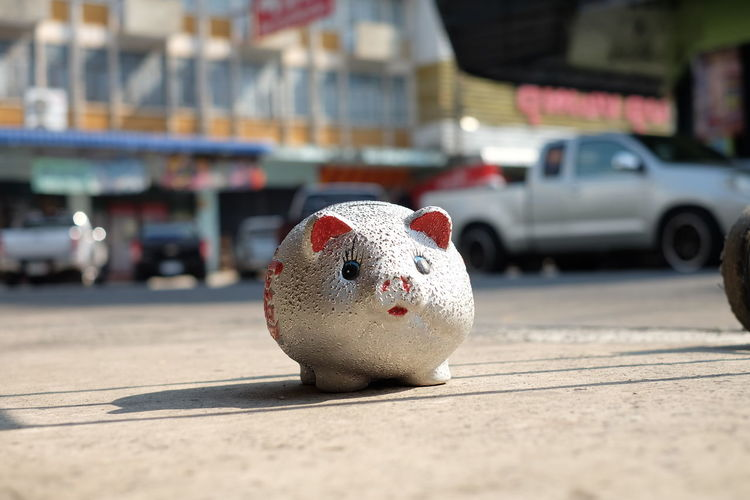 Close-Up Of Toy On Road In City